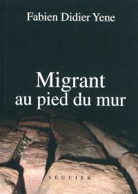 Migrant au pied du mur