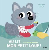 Au lit, mon petit loup ! : un livre à toucher